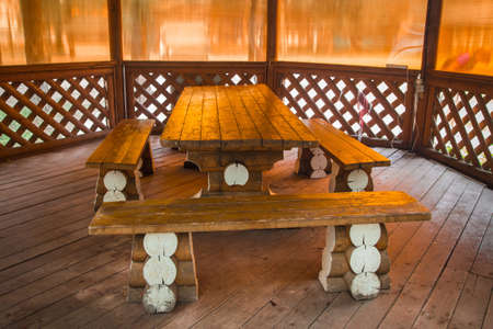 Wooden table and benches of pergola