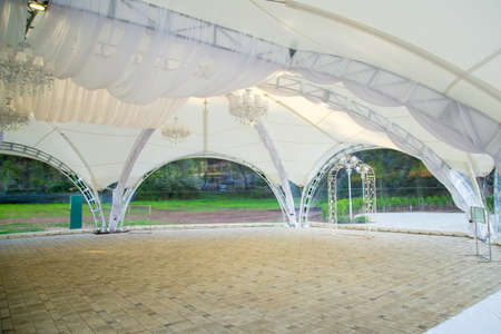 Image of white wedding canopy in summer