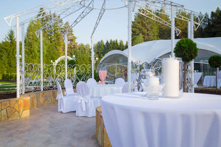 Image of empty wedding table with white tablecloth