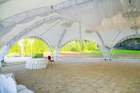 Photo of white wedding tent in summer Фото со стока