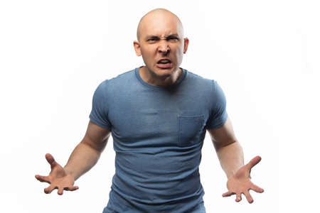 Photo of the adult angry bald man