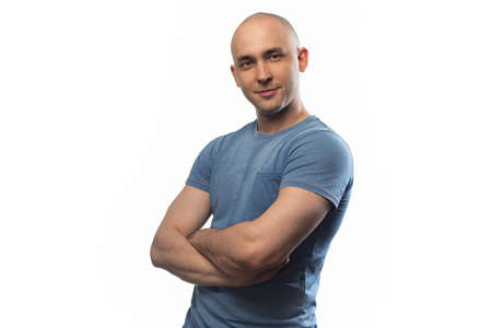 Photo of the bald man with arms crossed