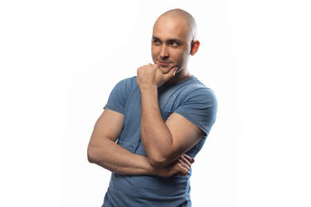 Photo of the smiling bald man with arms crossed Imagens