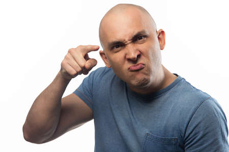 Photo of the adult angry bald man with forefinger