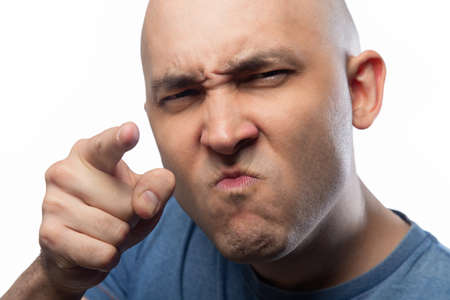 Photo of the bald man with forefinger Imagens