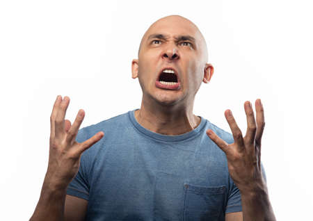 Photo of the adult crying bald man
