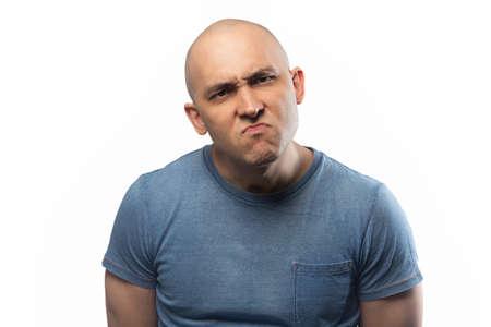 Photo of the adult gloomy bald man