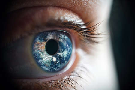 Macro photo of the womans eye and Earth planet Imagens