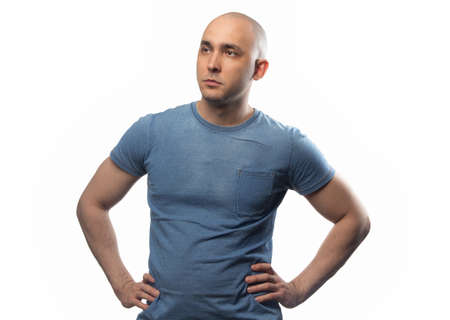 Photo of the bald man with hands on hips