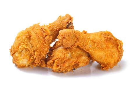 Fried crispy spicy chicken legs on white background Foto de archivo