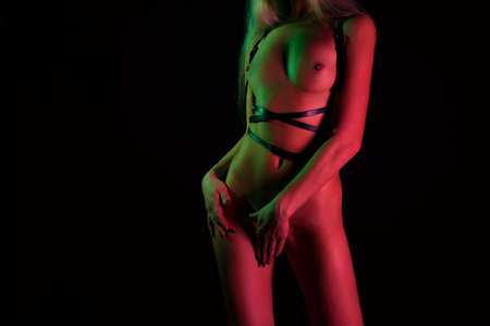 Photo of naked blond woman in belt Stock Photo