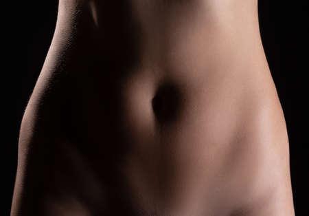 Photo of slim naked girls belly, closeup Stock Photo