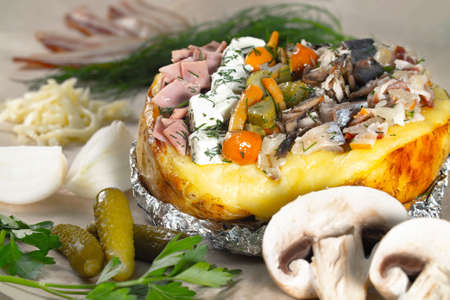 Photo of baked stuffed potato with different fillings