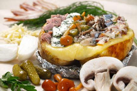 Photo of baked potato with different fillings on white background