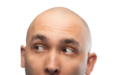 Image of young shaved mans head on white