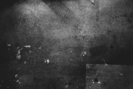Photo of old scratched surface texture in black white colors