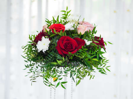Bouquet of red roses with green grass on white background