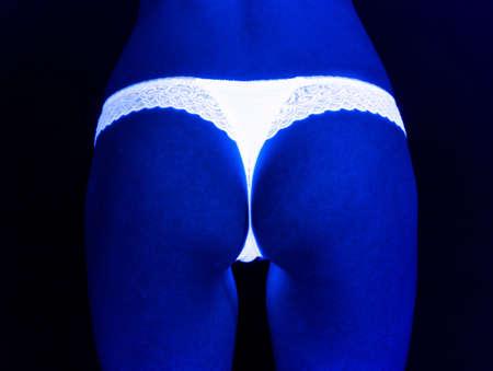 Image of girls buttocks in white lingerie