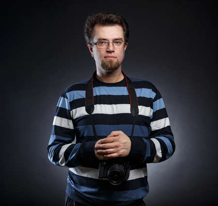 Image of bearded photographer with slr camera Imagens