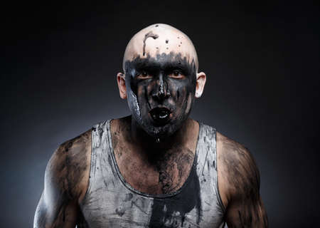 Image of bald mad man with black goo in the mouth Stock fotó