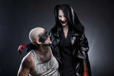 Mad dirty man and scary woman with blood hands Stock fotó