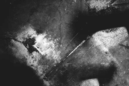 Photo of old scratched surface texture in black and white