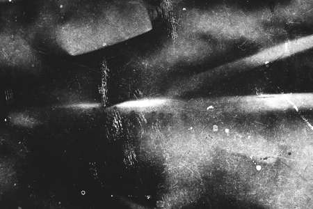 Image of scratched surface in black and white colors