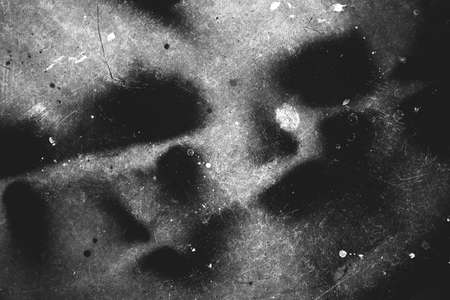 Photo of scratched surface texture in black and white colors