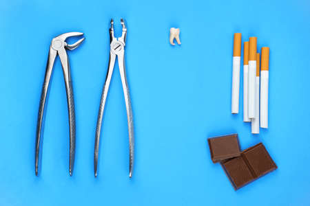 Photo of dental tools with removed tooth and chocolate