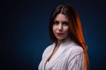 Image of brunette young woman with long hair and red lips