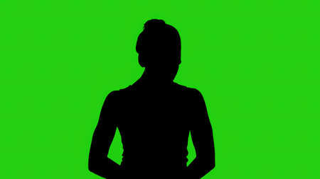 Girls silhouette with head down on green background Imagens