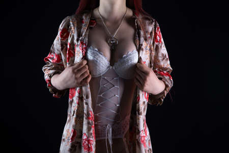 Photo of the adult woman in silk negligee Imagens