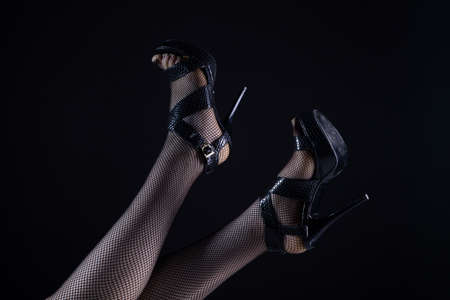 Photo of woman with legs up in fishnets and high heels shoes Imagens
