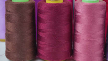 Shooting of colored bobbins of threads in workshop