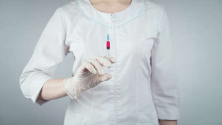 Shooting of woman and syringe with vaccine