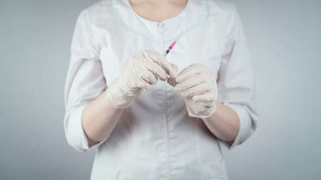 Photo of woman and syringe with vaccine