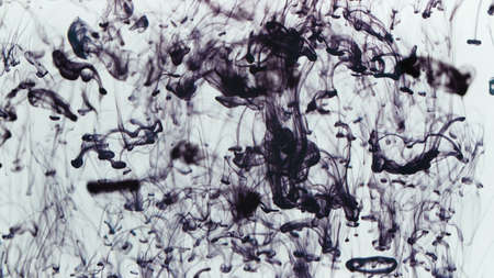 Image of drops of purple ink falling in liquid