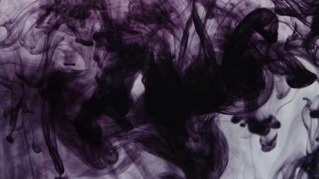 Pattern of drops of purple ink falling in liquid