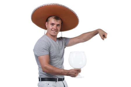 Photo of funny man in sombrero holding large glass for alcohol