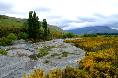 riverbed with mountains in the background