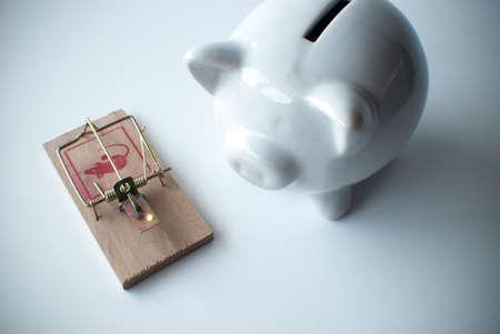 fraudulent: money trap mousetrap and piggy bank Stock Photo