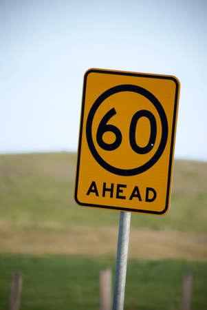advisory: advisory sixty kilometre per hour sign Stock Photo