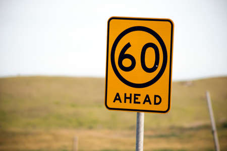 slowdown: advisory sixty kilometre per hour sign Stock Photo
