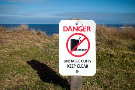 unstable: danger unstable cliffs keep clear sign Stock Photo