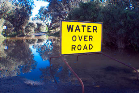 signage outdoor: signage of water over road