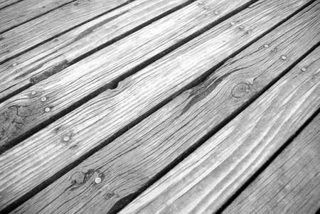 timbering: angled ground view of textured timber boardwalk