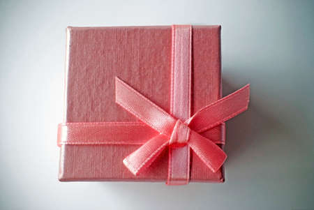 celebratory event: pink gift box with pink ribbon Stock Photo