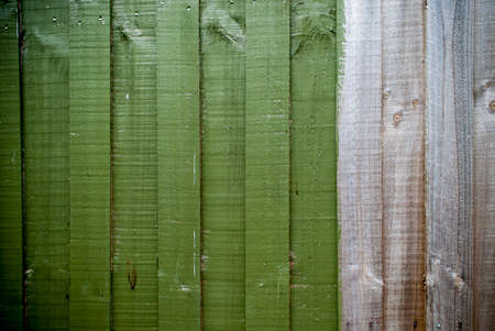 partially: partially painted green fence background Stock Photo