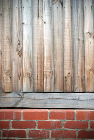 paling: timber fence on red brick wall