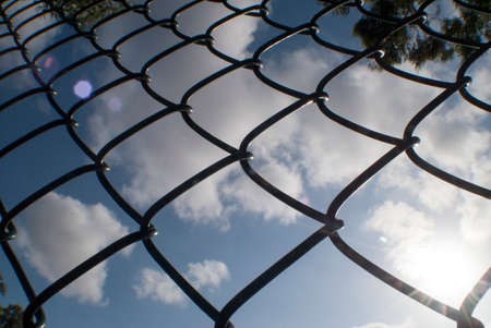 chain link fence: chain link fence with overcast sky